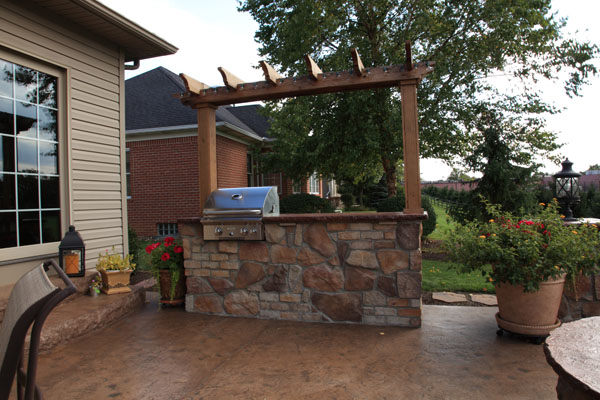 Arbor with Lights Over Grilling Island Kitchen and Concrete Countertop