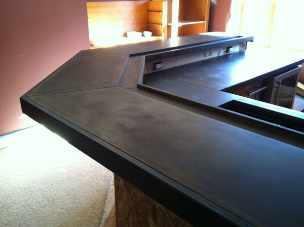 Industrial Concrete Countertop with Steel Edging and Drink Well