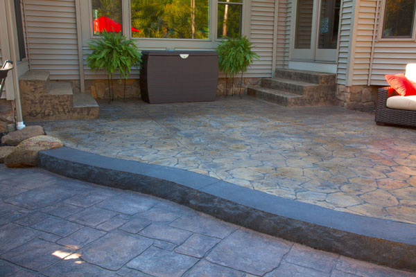 Two Tiered Concrete Patio with Border