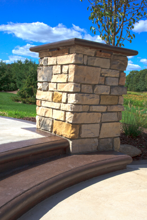 Custom formed concrete steps with cultured stone pillar