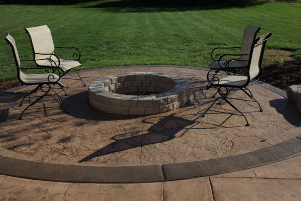 Old Granite Textured Patio with Built in Firepit