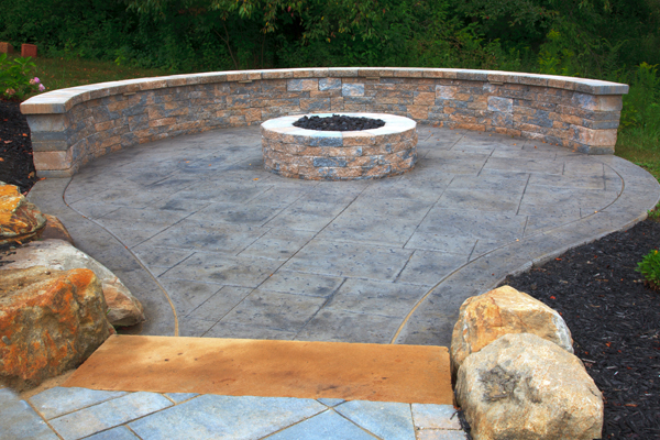 Techo Bloc Firepit and Seatwall on Stamped Concrete Patio