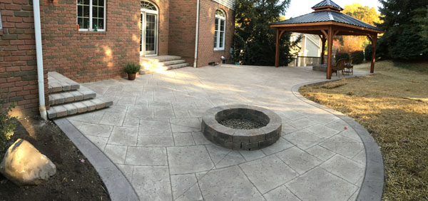 ... Stamped Concrete Firepit Patio With Dark Border