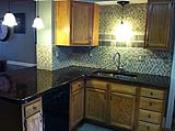 Glass Tiled Back Splash with Acid Stain Concrete Countertop