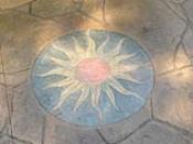 Stained Sunburst Concrete Inlay
