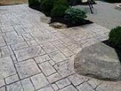 Pattern Concrete Patio with Rock Croppings