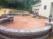 Circle Patio Finished with Seatwall and Pillars
