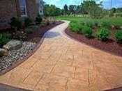 Tan Stamped Concrete Walkway with Dark Brown Border